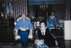 Opening Christmas presents (with my dad in the background), early 2000s.